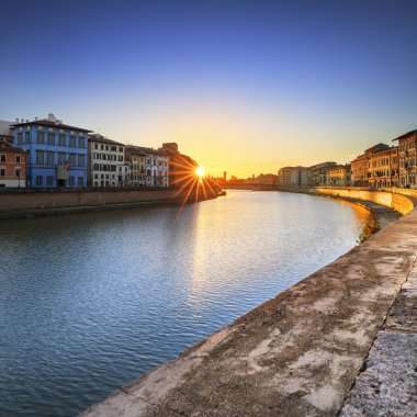 Pisa, Arno river sunset. Lungarno view. Tuscany, Italy