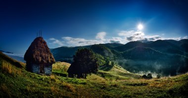 Beautiful mountain landscape in foggy morning in Romania