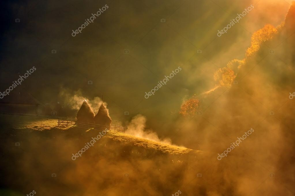 mountain landscape with autumn morning fog