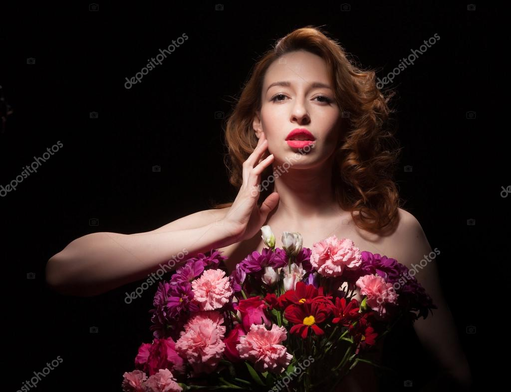 Beautiful woman with flowers stock photo oshepkov1962 106609064 beautiful woman with flowers on a black background photo by oshepkov1962 izmirmasajfo