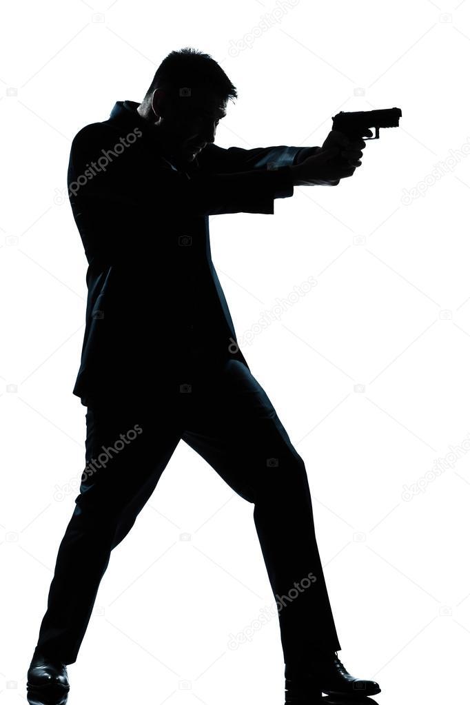 silhouette homme pleine longueur de tir avec arme à feu ...