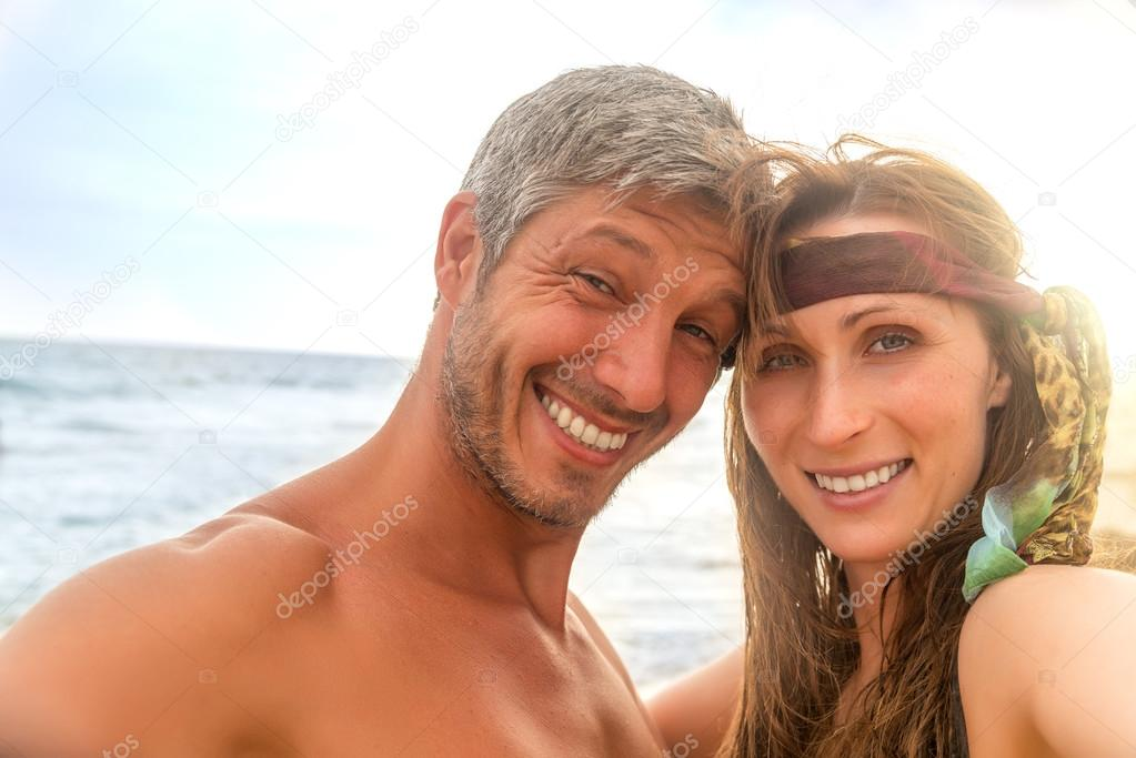 smiling couple on seaside