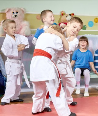Children learn in training judo sparring