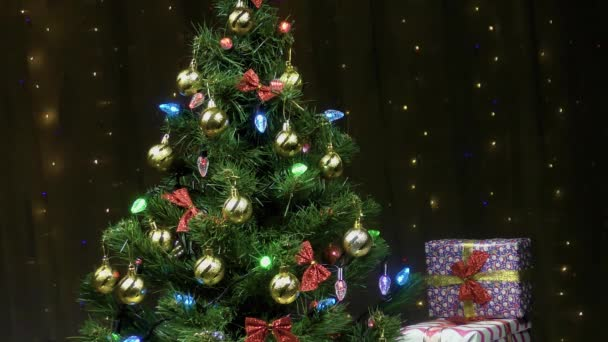 Christmas video card with a beautiful Christmas tree decorated with toys and garlands