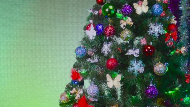 Christmas tree decorated with different colorful toys on a green background