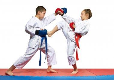 Young athletes beats kick leg and hand