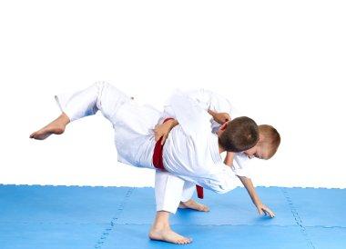 Sportsmens are training judo throws