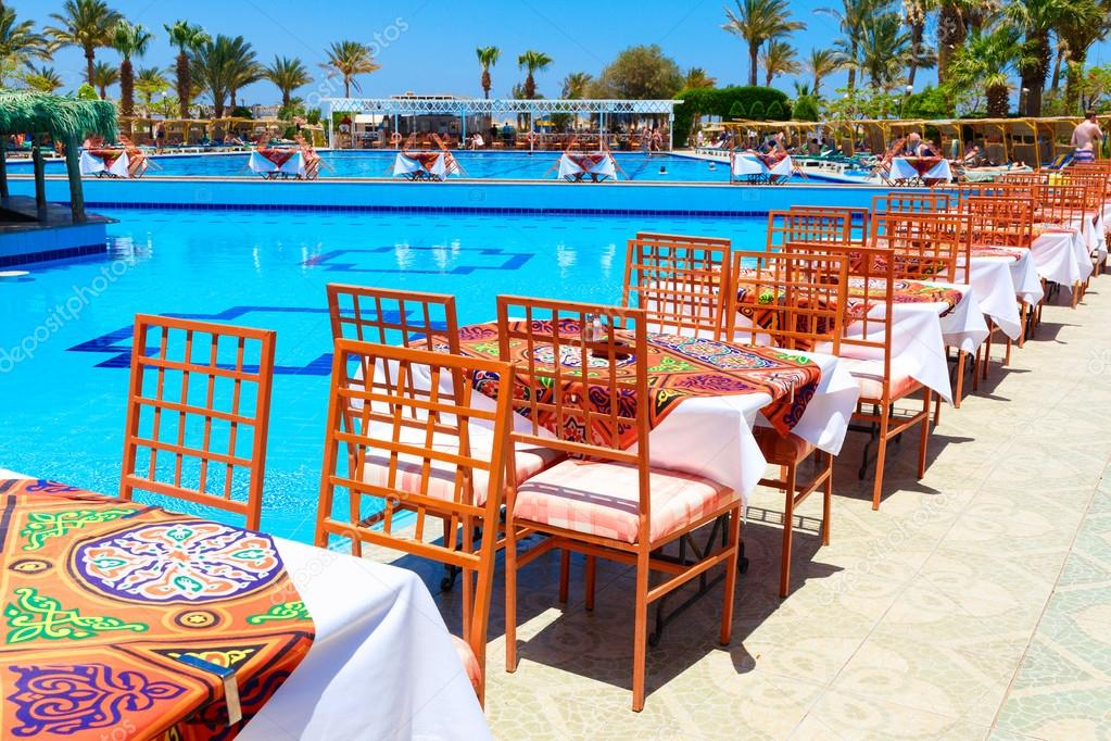 HURGHADA, EGYPT   MAY 16, 2015: Swimming Pool With Tables For The Meal U2014  Photo By Aksakal