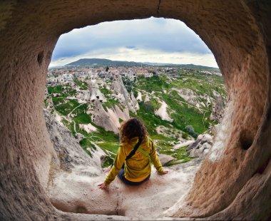 Woman sitting in Cappadocia valley of Turkey