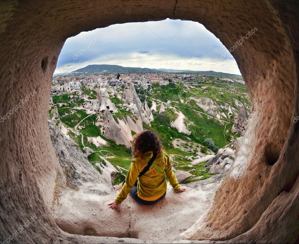 Woman sitting in Cappadocia valley of Turkey