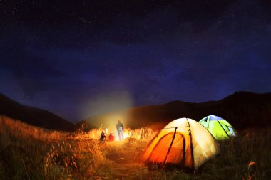 Camping under the stars at night