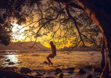 Woman relaxing on a swing on the beach , Koh Rong Samloem ,Cambodia