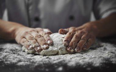 Professional baker preparing dough