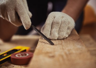 Woodworker with chisel