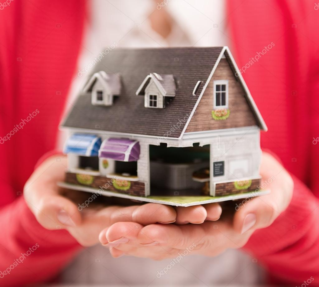 Closeup Of Woman Mortgage Consultant Holding House Model. Concept Of New  Home Sale Or Rent. Shallow Depth Of Field. U2014 Foto Von Stasique