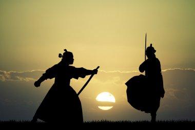 Fighting Samurai at sunset