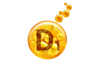 Vitamin D1 capsule. Golden balls with bubbles isolated on white background. Healthy lifestyle concept.
