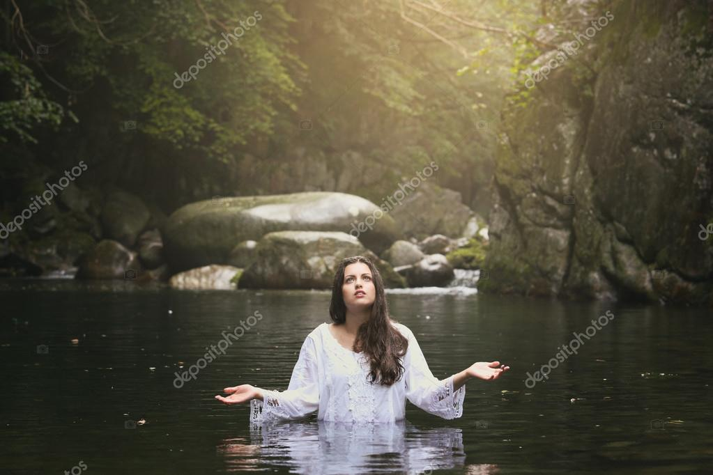 Beautiful young woman praying