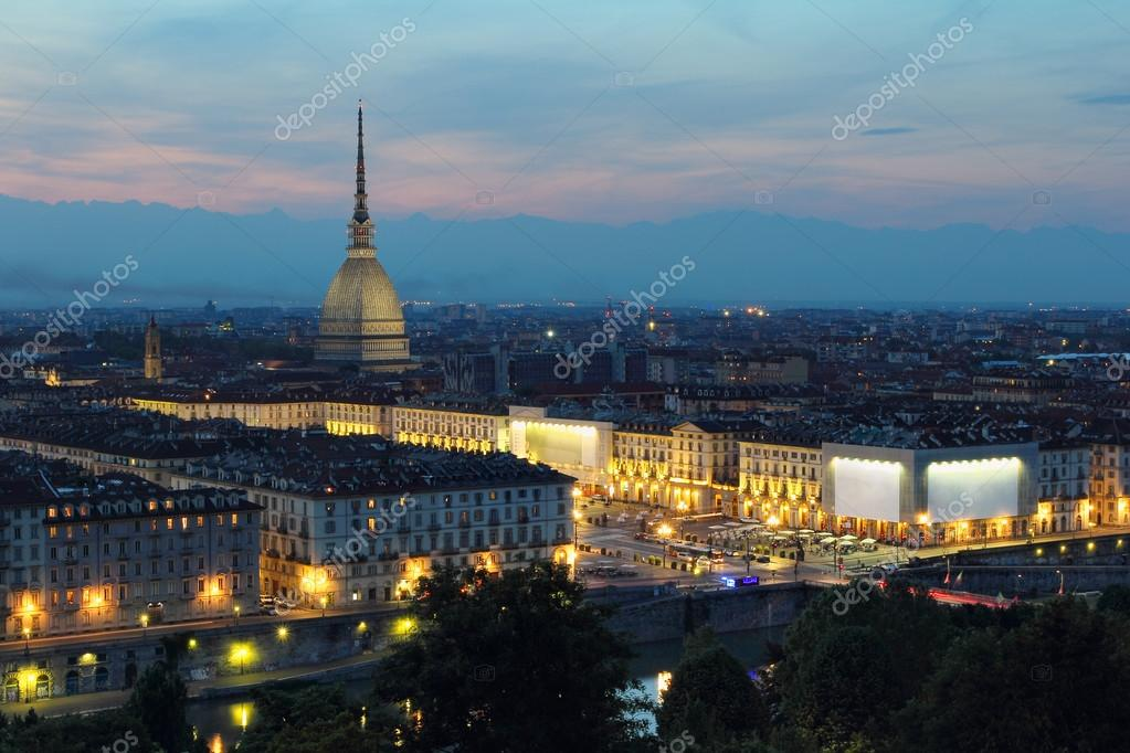 Turin and Mole Antonelliana lighted at dusk — Stock Photo ...