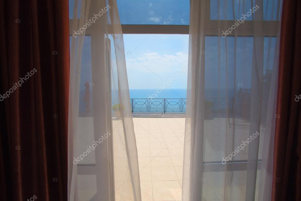 view of the sea from a hotel room