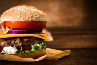 Beef burger with cheese and vegetables