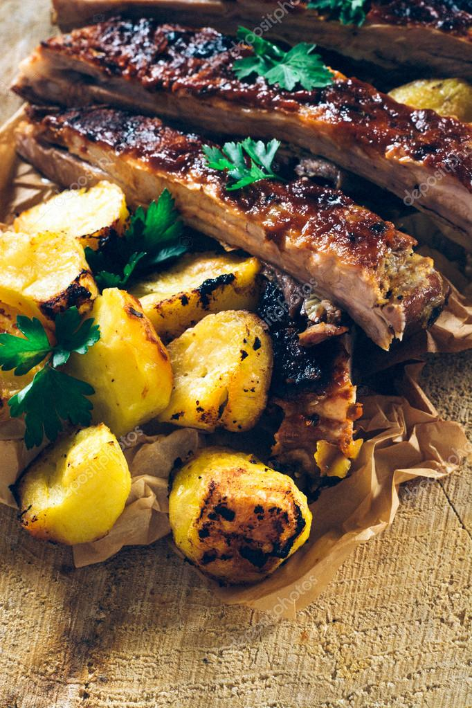Baked potato and beef ribs