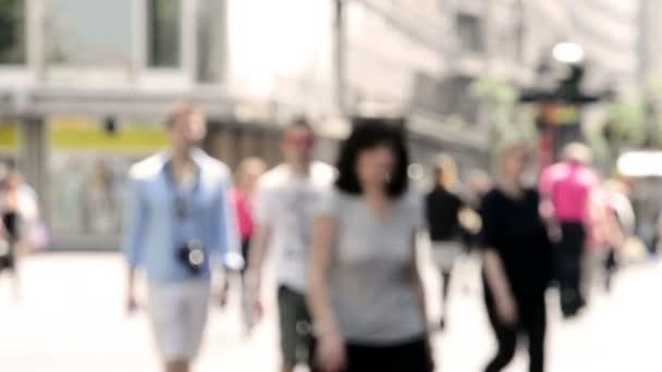 Blurred people on street