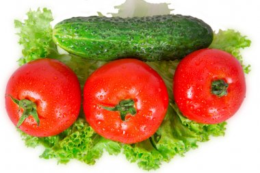 Three tomatoes and cucumber