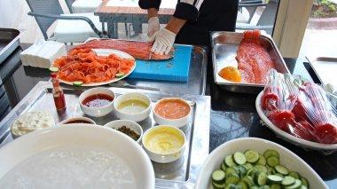 Chef Slicing Smoked Salmon Fish