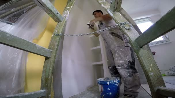 Young Worker Plastering An Interior Wall