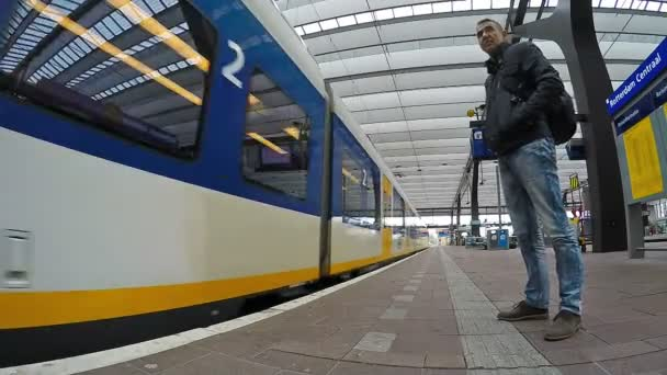 Man Beside High Speed Train at Rotterdam Central Station