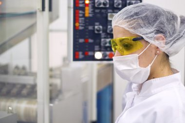Woman Operating The Control Panel - Pharmaceutical Manufacturing
