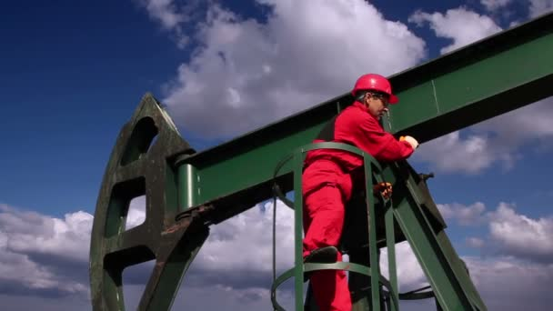 Worker at Pump Jack Oil Well