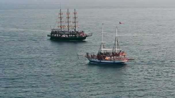 People traveling on sailing Ships