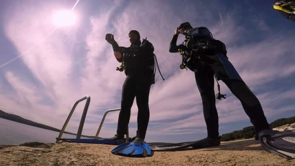 Three Scuba Divers Preparing for Dive