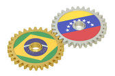 Venezuela and Brazil flags on a gears, 3D rendering