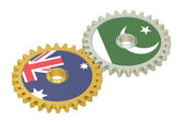 Australia and Pakistan flags on a gears, 3D rendering