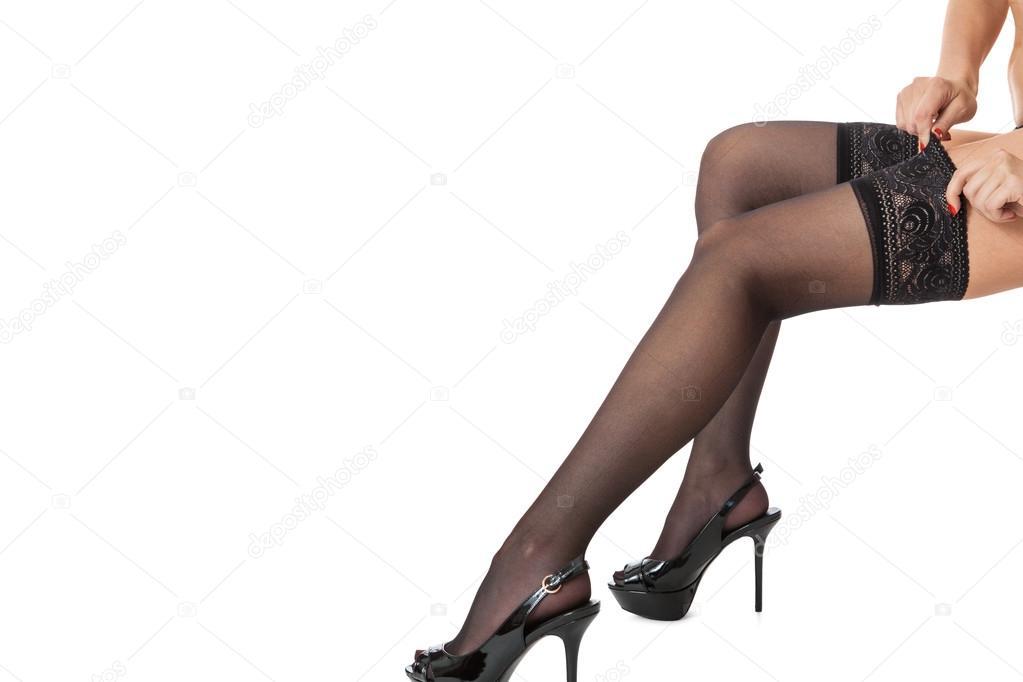 Сексуальные женские ножки в чулках и каблуках