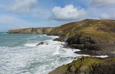 Rugged Cornwall coast with waves at Trebarwith Strand Cornwall England UK coastal village between Tintagel and Port Isaac