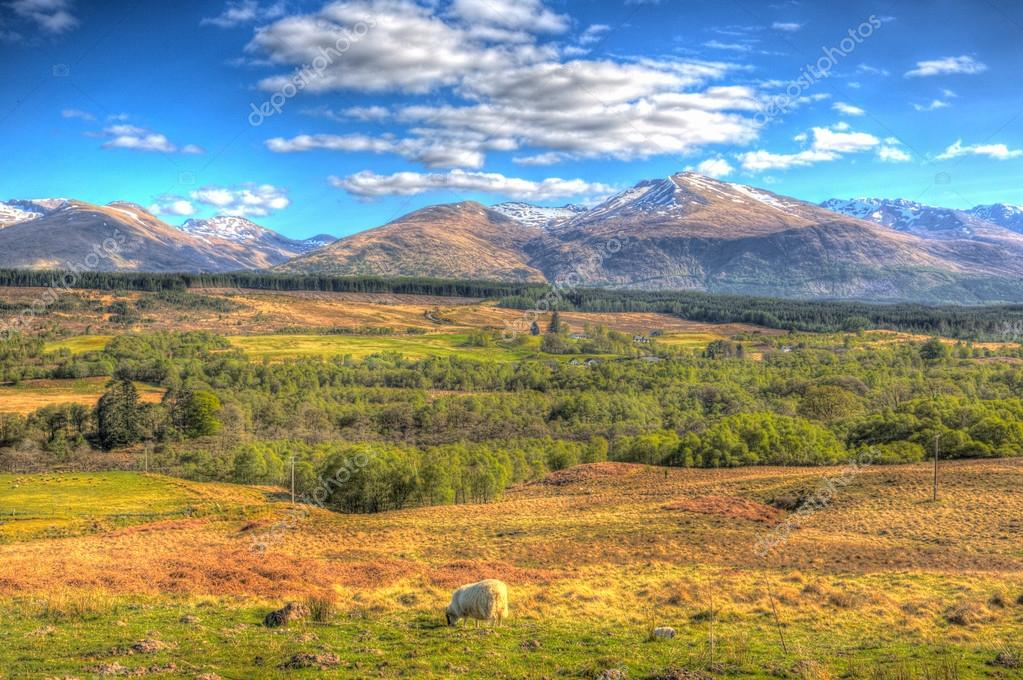 Scottish countryside and snow topped mountains Ben Nevis Scotland UK in the Grampians Lochaber Highlands close to the town of Fort William in colourful HDR