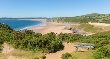 Pobbles beach The Gower Peninsula Wales uk popular tourist destination and next to Three Cliffs Bay in summer with blue sky and sea
