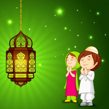 Muslim kids offering namaaz for Eid
