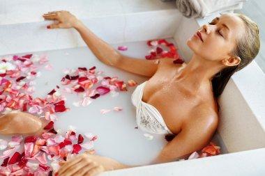 Woman Spa Flower Bath. Aromatherapy. Relaxing Rose Bathtub.