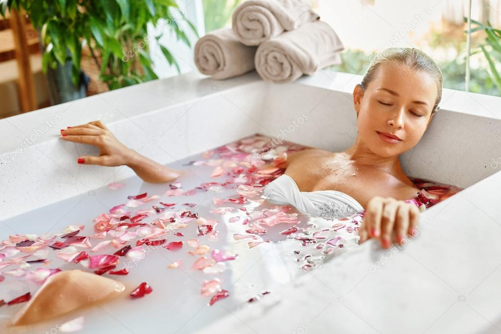 Woman Spa Flower Bath. Aromatherapy. Relaxing Rose Bathtub. — Stock ...