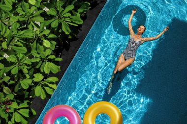 Summer Relax. Woman Floating, Swimming Pool Water. Summertime Holidays