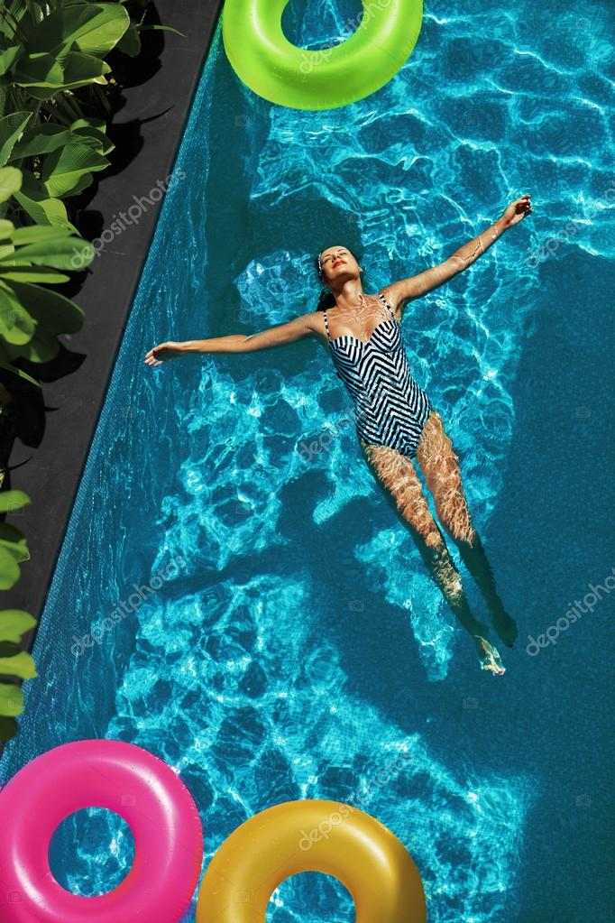 Contemporary Pool Water With Float Happy Young Woman Sexy Body In Swimsuit Having Fun Colorful Swim Rings Floating Swimming T Ideas