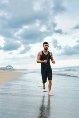 Running Man Jogging At Beach During Fitness Workout Outdoor. Sport