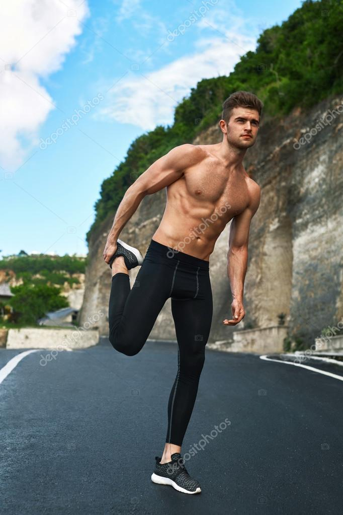 Muscular Man Doing Calisthenic Exercise Isolated On The