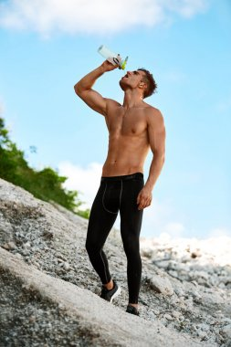 Hot Thirsty Man Drinking Water Drink After Running Outdoors. Sport