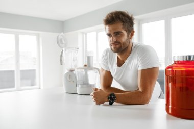 Sport Nutrition. Healthy Man Going To Prepare Shake In Kitchen